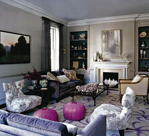 livingroom with pink poufs