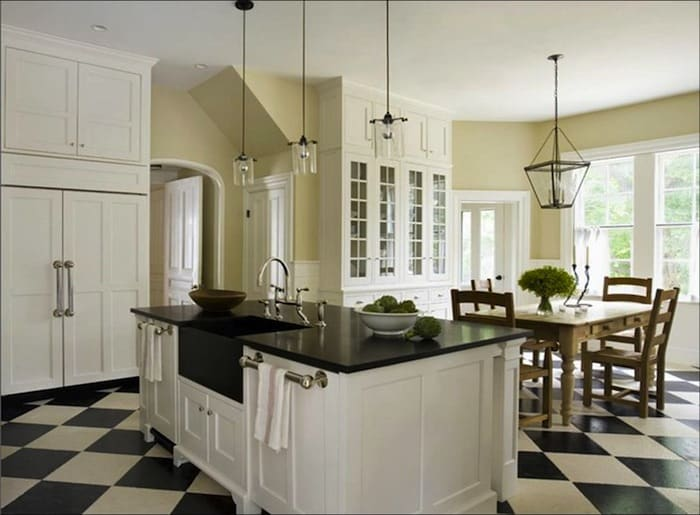 eric_roth_kitchen_white_traditional_cabinets_check_checkered_tile_floor_black_granite_countertops_lantern_pendant_light_chandelier_farmhouse_table