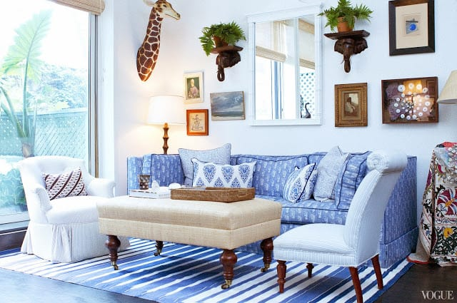 blue living room striped dhurrie rug elephant giraffe wall hanging new york city cococozy vogue