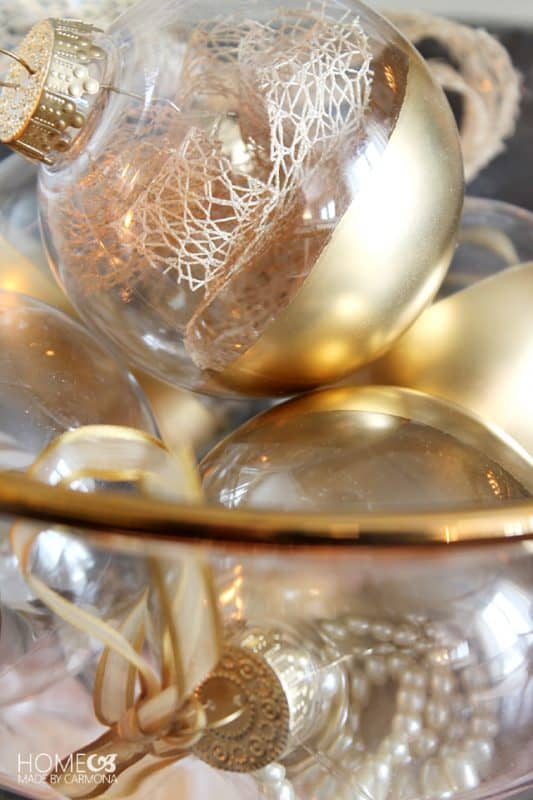 bowl of gold dipped ornaments on coffee table