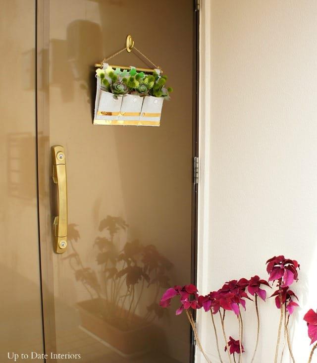 DIY shamrock wall hanging on front door