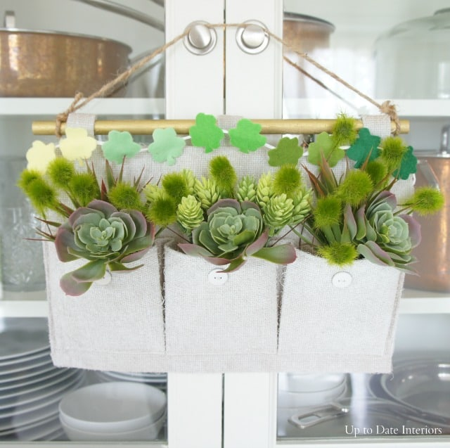 faux succulent wall planter with shamrock bunting