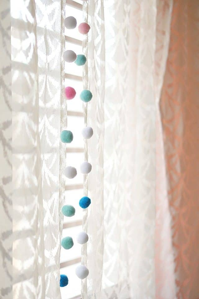 rental decorating hack window with sheer and pom poms