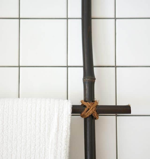 diy blanket ladder holding towels