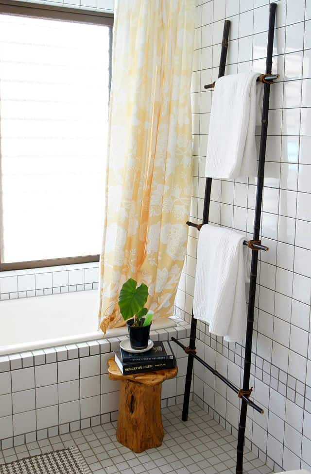 bright and sunny Japanese bathroom with a DIY blanket ladder for towels