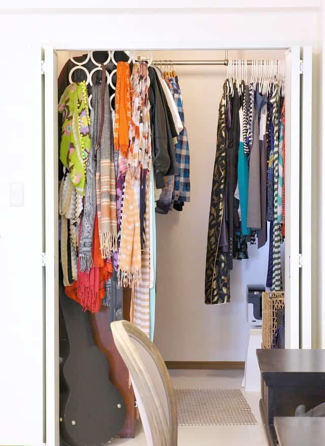 the kon mari method in a master bedroom walk in closet