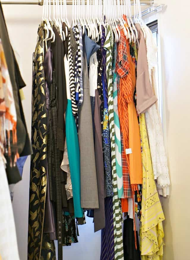 declutter and organize clothes in the closet, clothes hanging