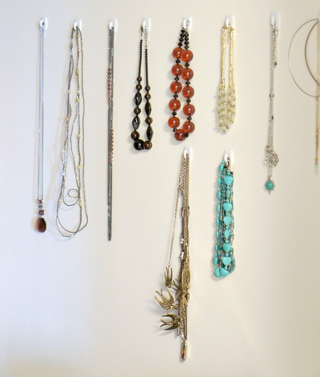 necklaces hanging on command strip hooks in the closet for renter friendly jewelry display and storage