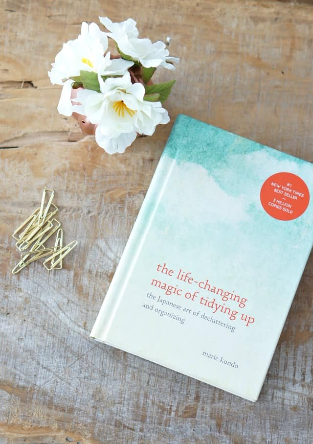 The Kon Mari Method, Book on table with flowers and paper clips