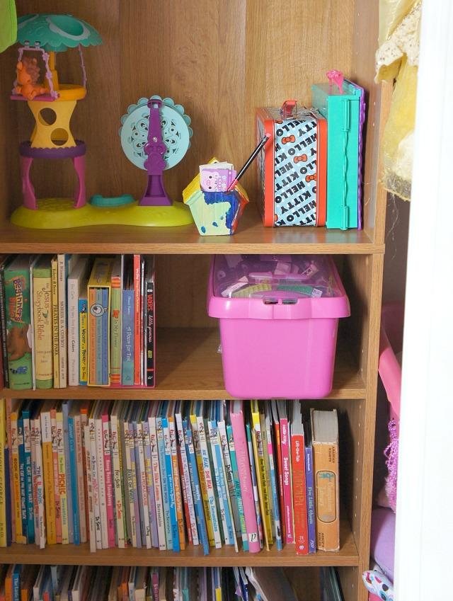 a bookshelf in the closet helps declutter kids rooms
