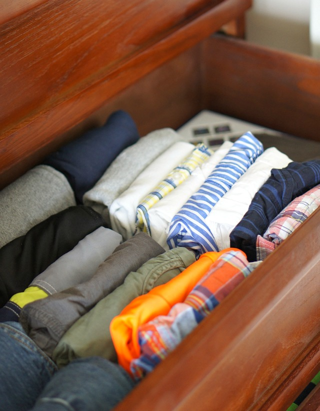 Clothes folded neatly the konmari way to declutter the kids rooms.