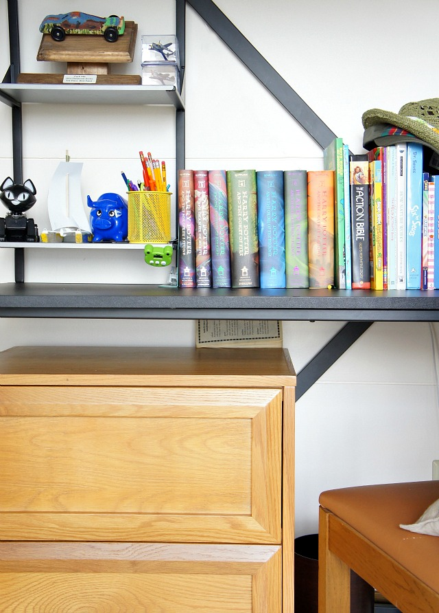 a neat desk with books and a few toys