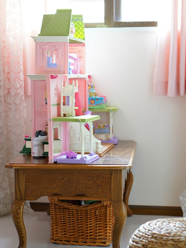 declutter kids rooms by organizing items by type and storing them together.