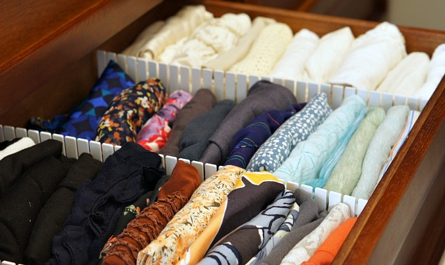 Clothes folded using the konmari method in a drawer