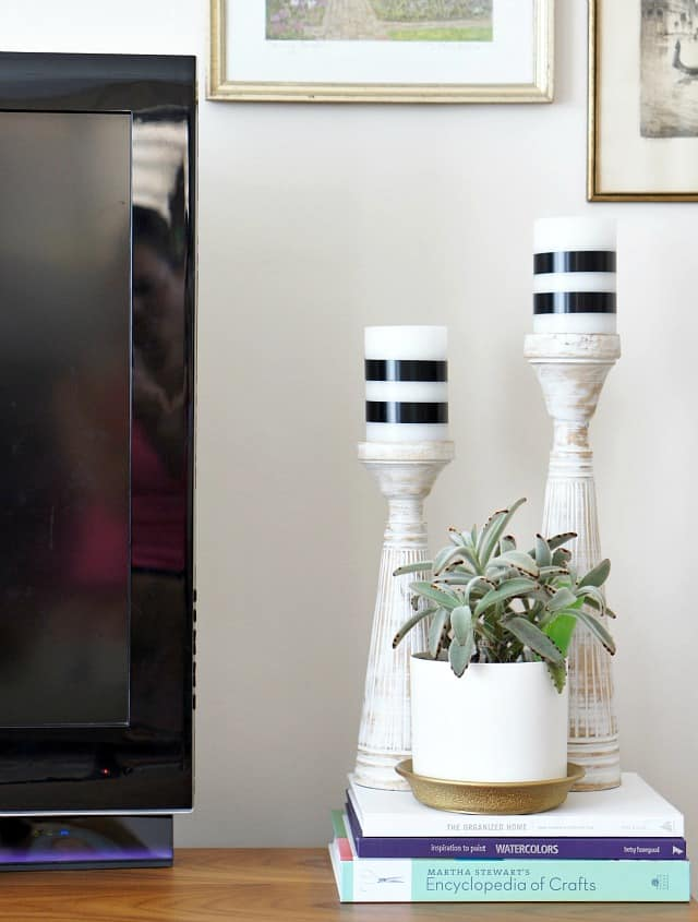 wrap black tape around white pillar candles