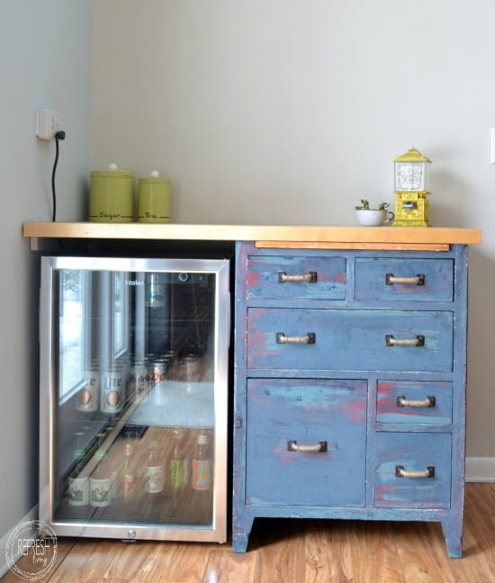 custom-counter-with-beverage-fridge-and-antique-cabinet