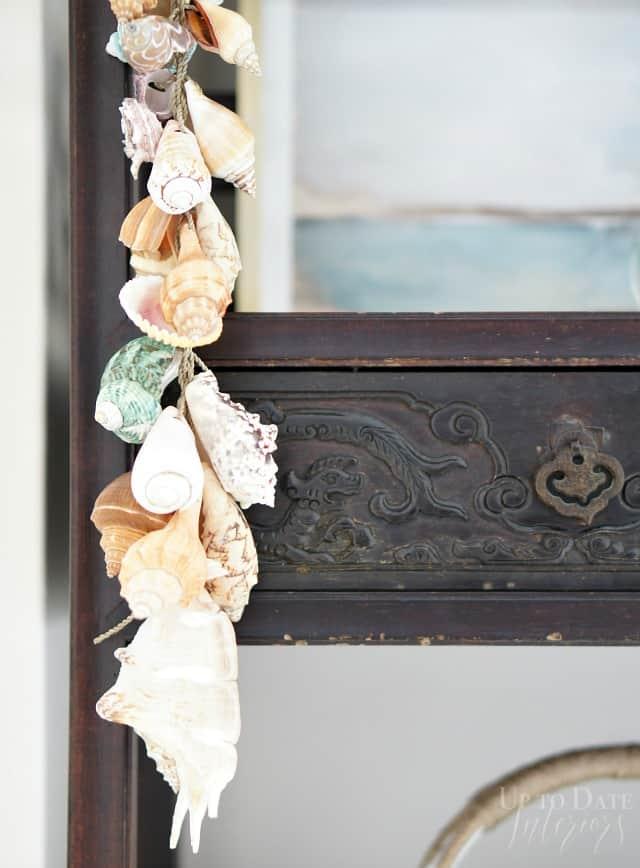 hanging seashells on bookcase