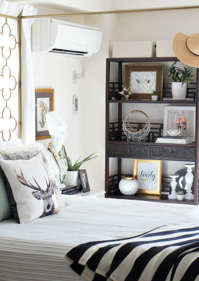 bedroom bookcase and neutral decor
