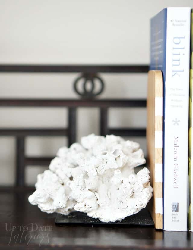 coral bookend on bookcase
