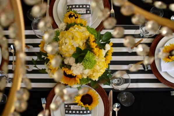 black-white-themed-tablescape-through-chandelier-597x400