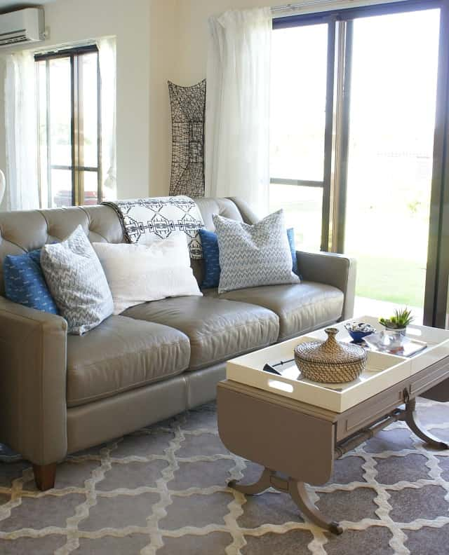 leather couch with white and blues
