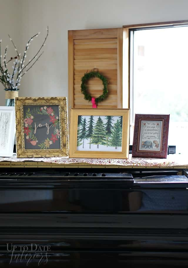 piano with art display and wooden shutters