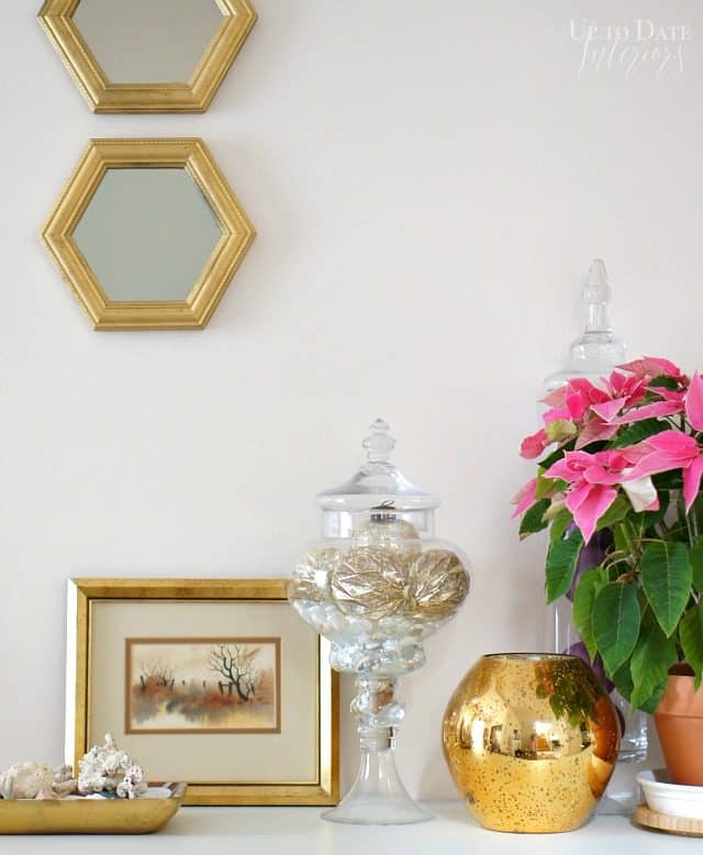 use warm metallics in your decor for a winter vignette