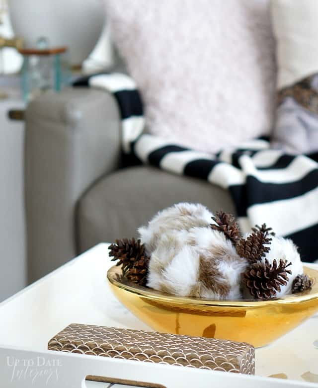 winter accessories with fur ornaments and pinecones