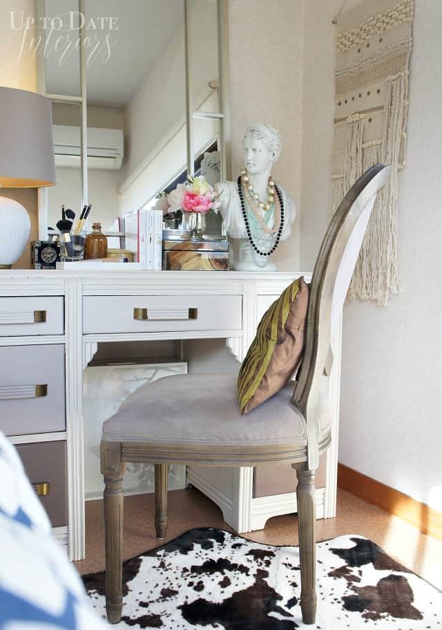 desk used as vanity in a rental bedroom