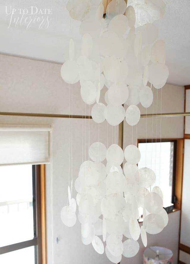 capiz shell chandelier in bedroom