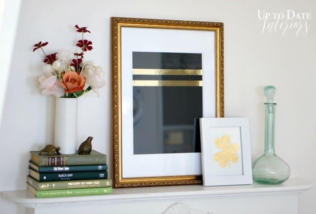 DIY gold leaf shamrock and books on fireplace mantel