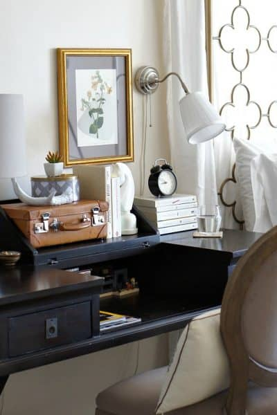 use a desk as a bedside table and renter friendly wall sconce