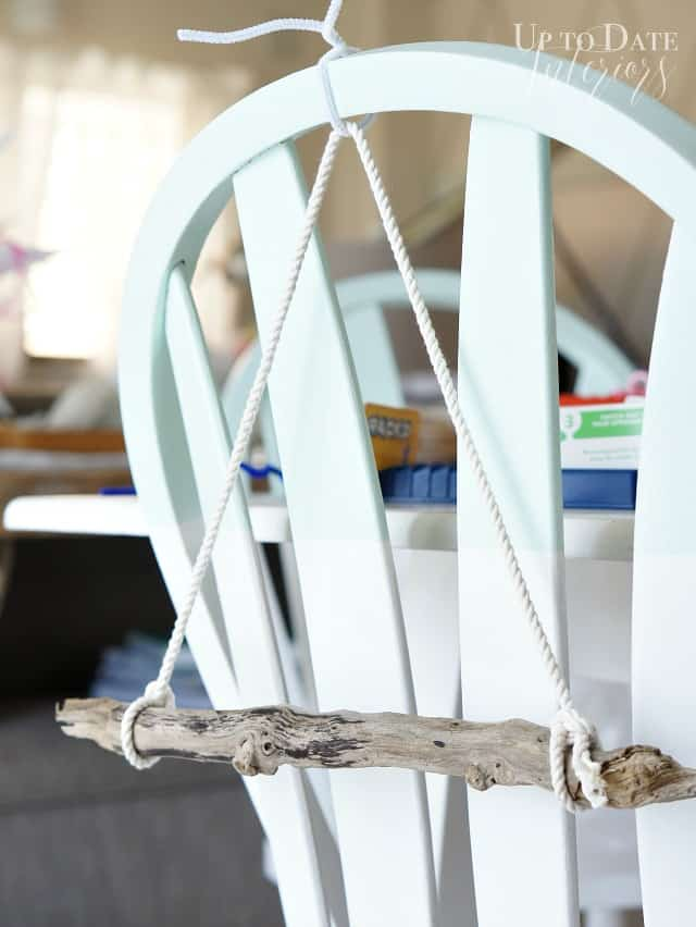 Driftwood wall hanging from pipe cleaner on chair for easy assemble.