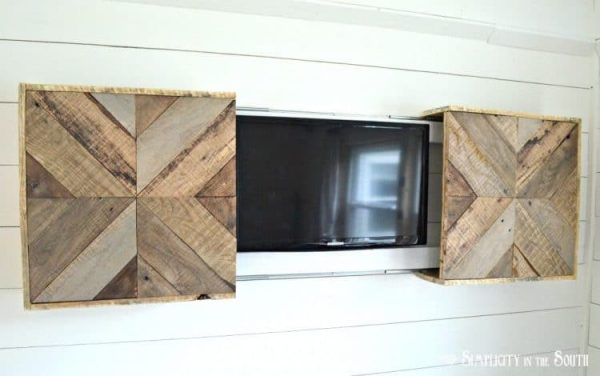 DIY-reclaimed-wood-sliding-TV-cover-hidden-television-750x470