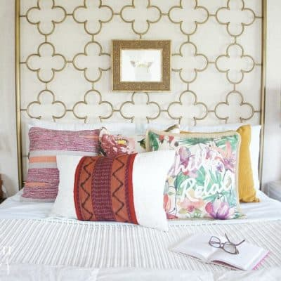 Iris-apfel-inspired global bedroom with layered prints and necklaces