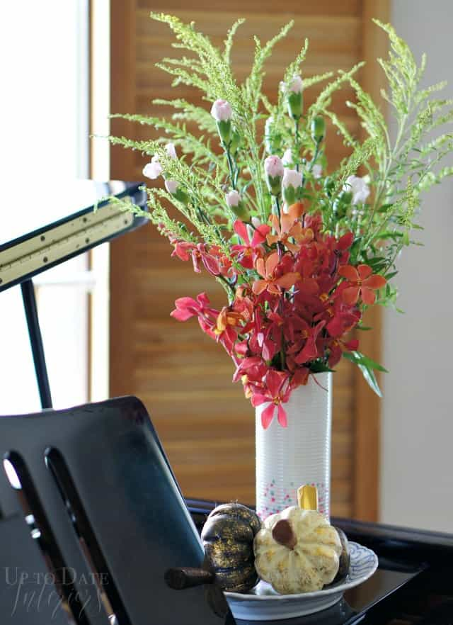fall flowers and pumpkins on the piano