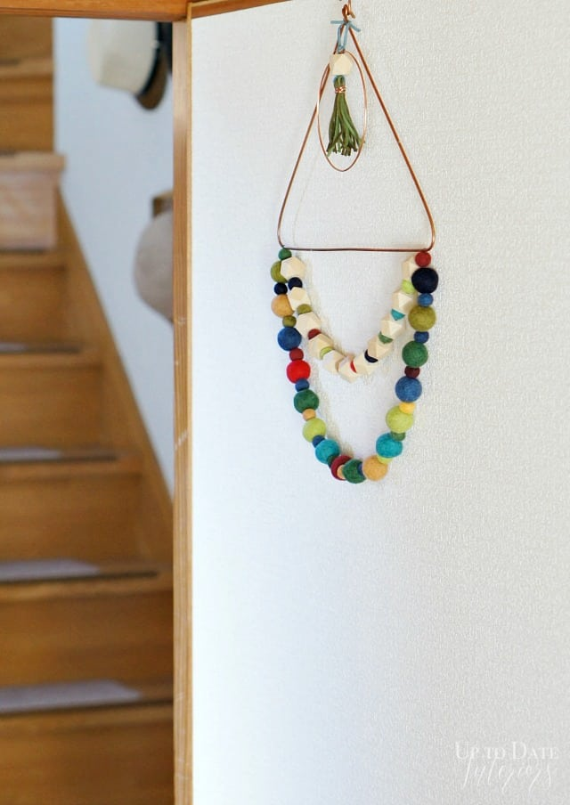 eclectic global door hanging with wool and wood beads and leather tassel