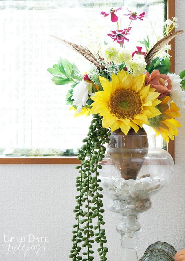 fall flower arrangement in the foyer
