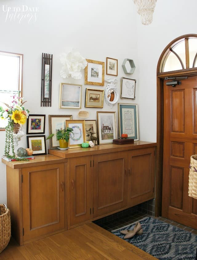 eclectic boho gallery wall in the foyer