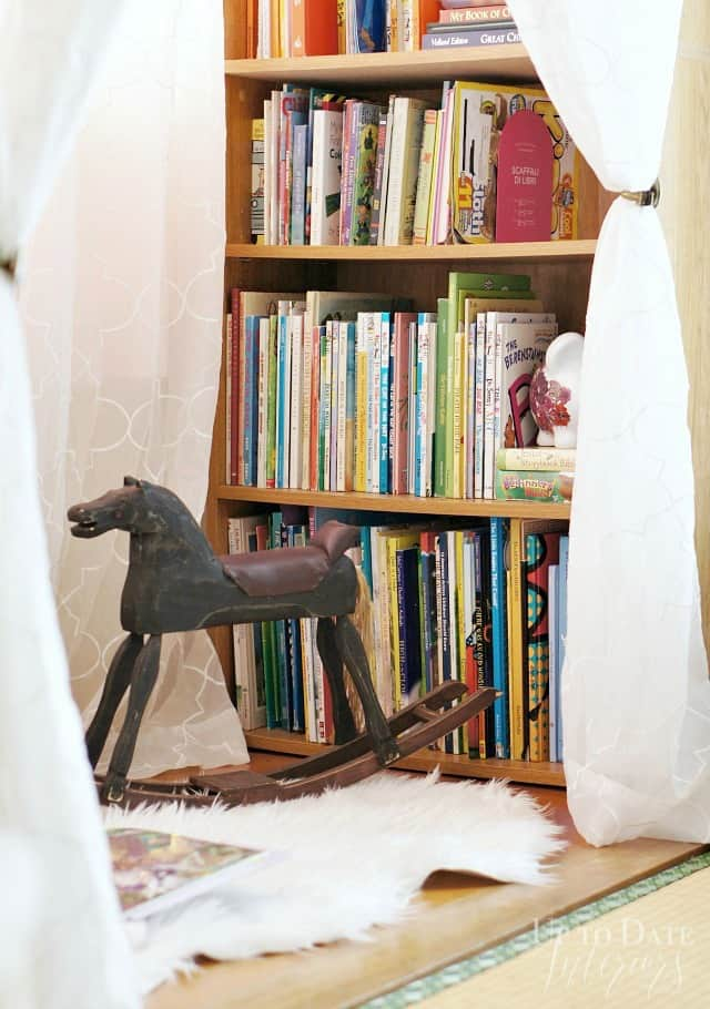 renter bedroom reading nook for girl with bookcase and chair