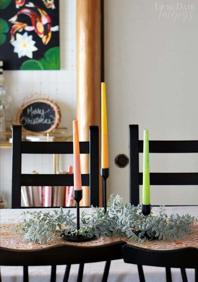 two toned painted candles for a simple scandi christmas table centerpiece