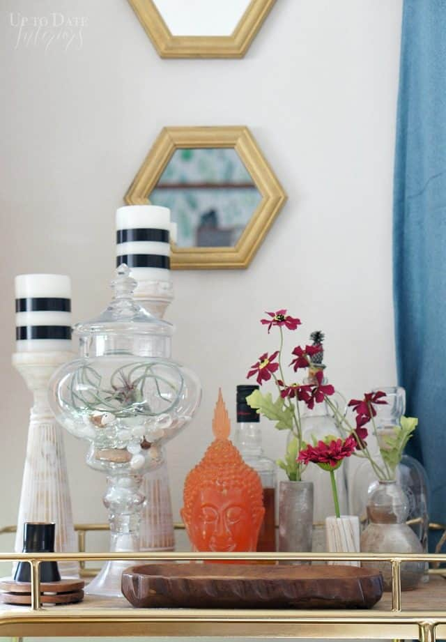 eclectic spring decor on a bar cart