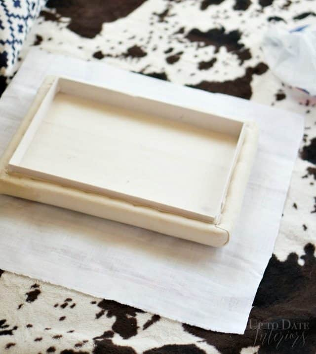 fabric-cut-out-ottoman-makeover