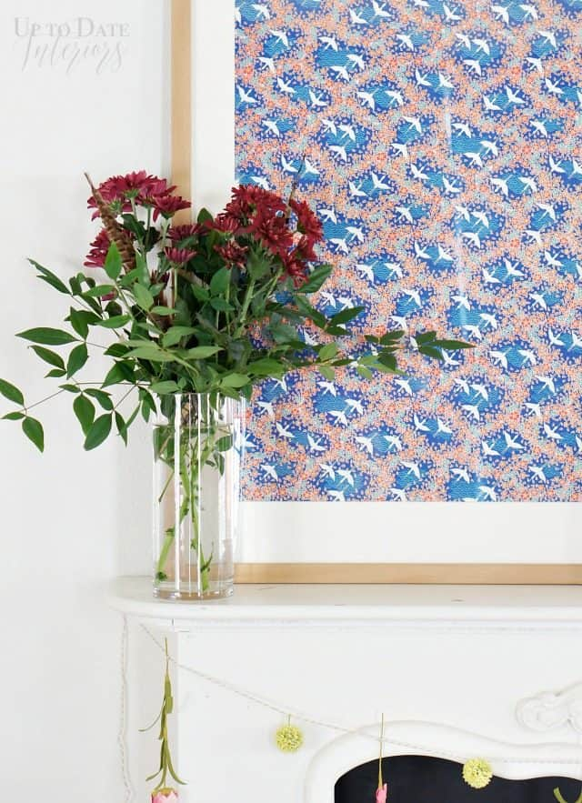 spring mantel decorating idea with fresh flowers and colorful art