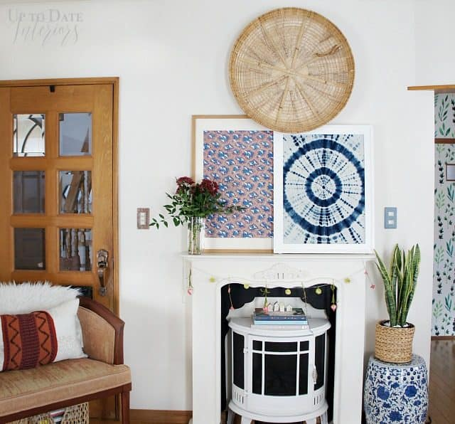 a global eclectic living room decorated for spring with red and blues
