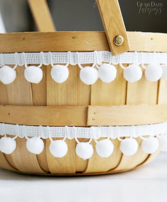natural-basket-with-white-pom-pom-trim