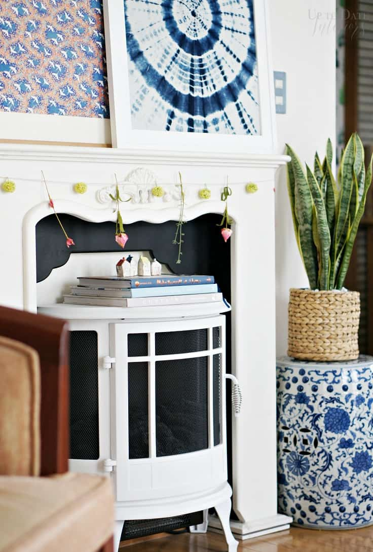 Nordic Spring Garland on mantel with white space heater and shibori art
