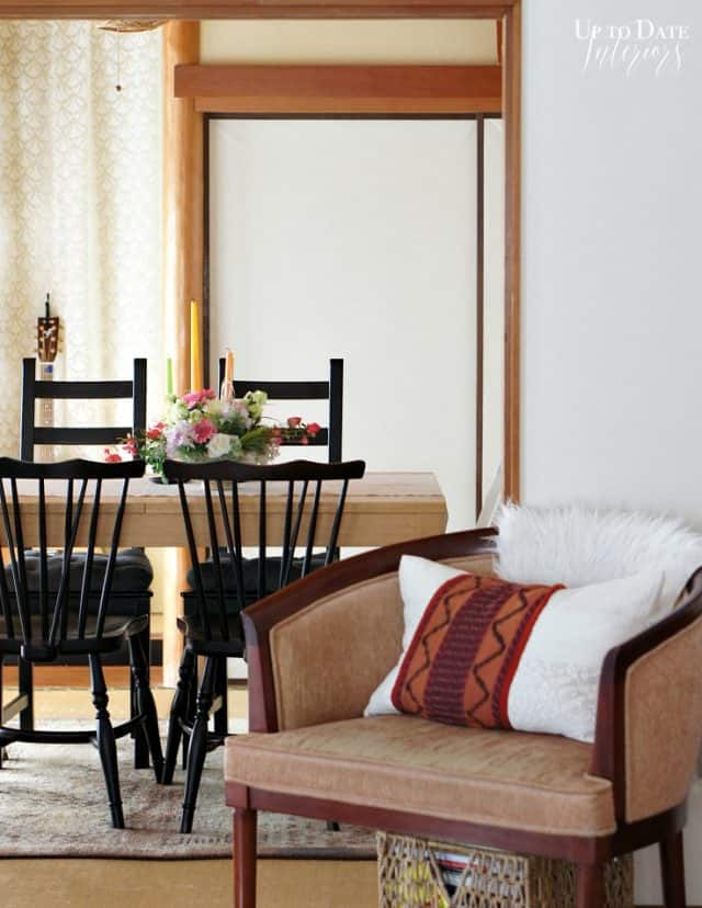 natural wood architecture and dining set with brown chair and eclectic spring decor