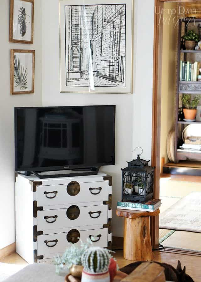spring home tour tv corner on campaign chest and black and white art work