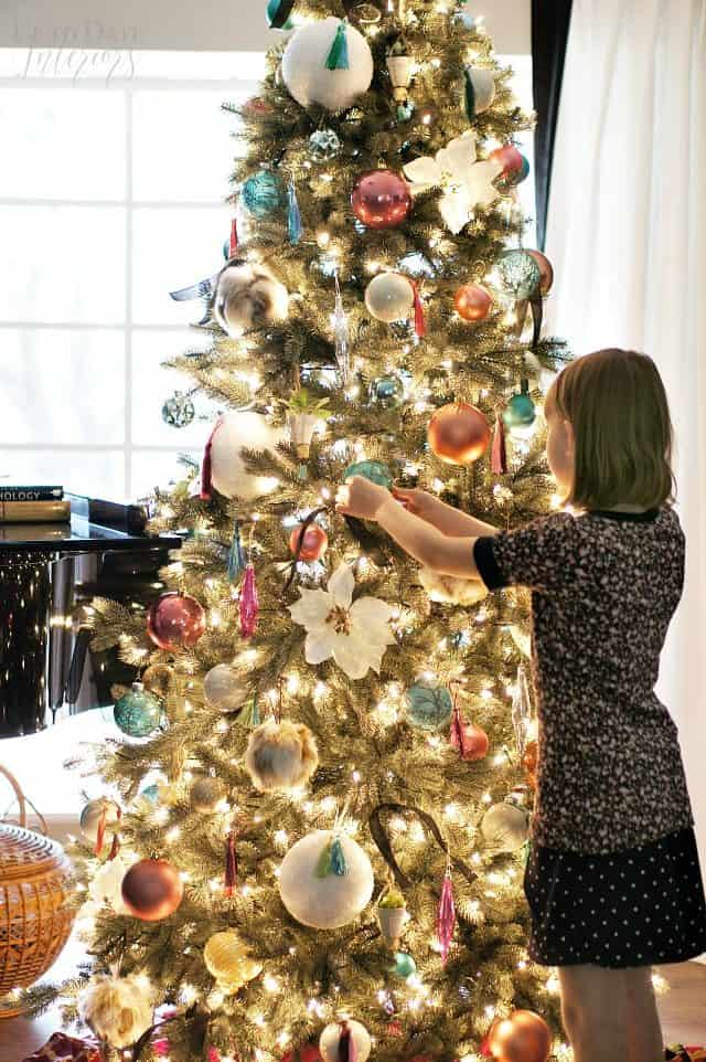 Child Decorating Christmas Tree